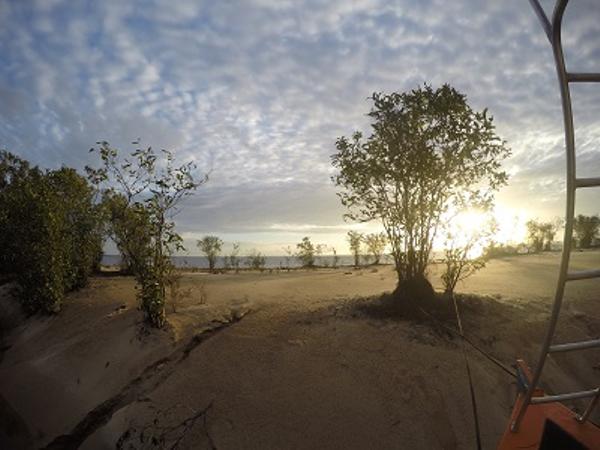 Sunrise over a river beach